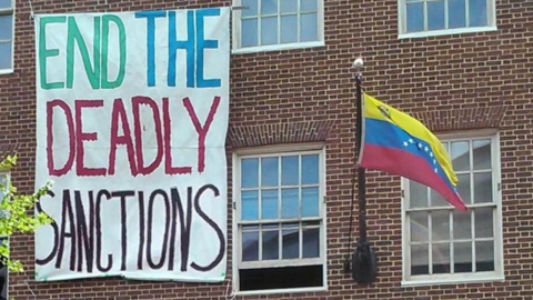 Solidarity activists defend the Venezuelan Embassy in Georgetown from US efforts to turn it over to representatives of coup leader Juan Guaido. (Medea Benjamin and Kevin Zeese)